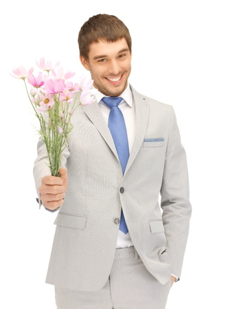 gift giving: picture of handsome man with flowers in hand