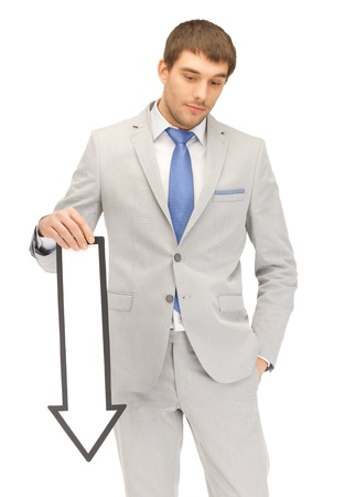 man looking down: picture of attractive businessman with direction arrow sign
