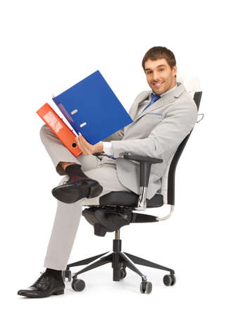 bright picture of handsome man with folders Stock Photo - 13469261
