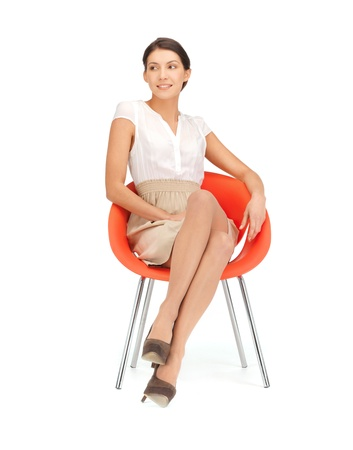 one of a kind: picture of young businesswoman sitting in chair