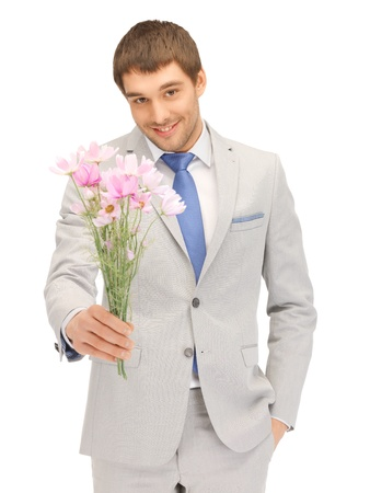 one of a kind: picture of handsome man with flowers in hand