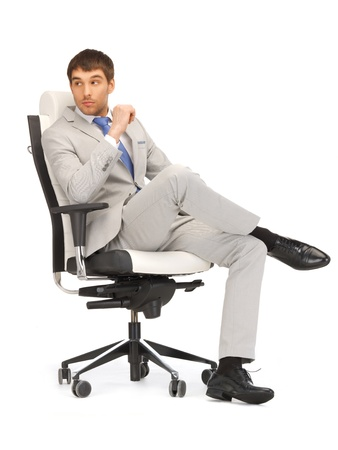 sitting chair: picture of young businessman sitting in chair Stock Photo