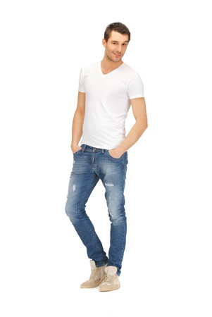 standing man: bright picture of handsome man in  white shirt