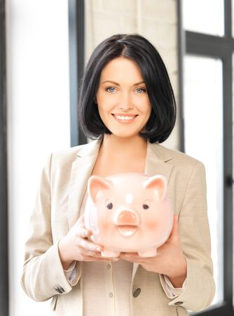 finance girl: picture of lovely woman with piggy bank