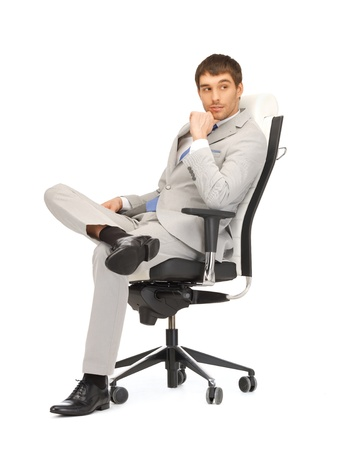 picture of young businessman sitting in chair photo
