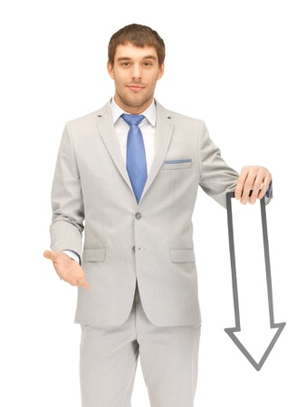 down arrow: picture of attractive businessman with direction arrow sign