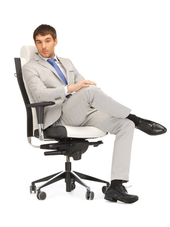 executive chair: picture of young businessman sitting in chair Stock Photo