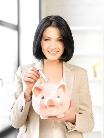 finance girl: picture of lovely woman with piggy bank and money