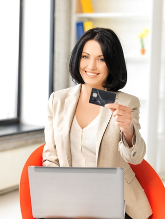 picture of happy woman with laptop computer and credit card Stock Photo - 13772807