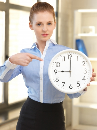 late teens: bright picture of attractive businesswoman with clock