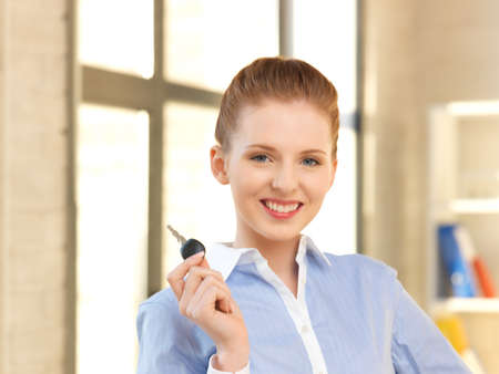 bright picture of happy woman with car key photo