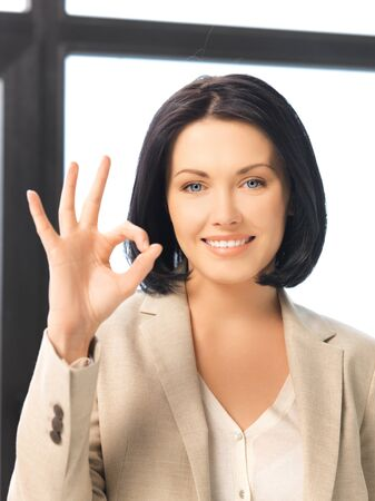 bright picture of young woman showing ok sign photo