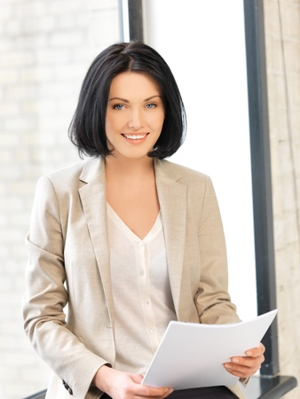 indoor picture of happy woman with documents Stock Photo - 13818645