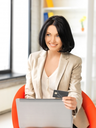 picture of happy woman with laptop computer and credit card Stock Photo - 13818634