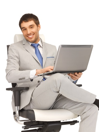 picture of young businessman sitting in chair with laptop photo