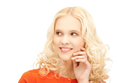 business dilemma: bright studio picture of beautiful pensive teenage girl