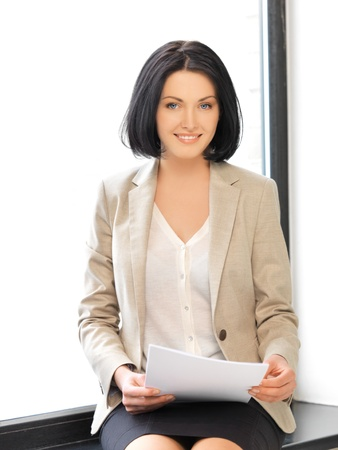 scholar: indoor picture of happy woman with documents Stock Photo
