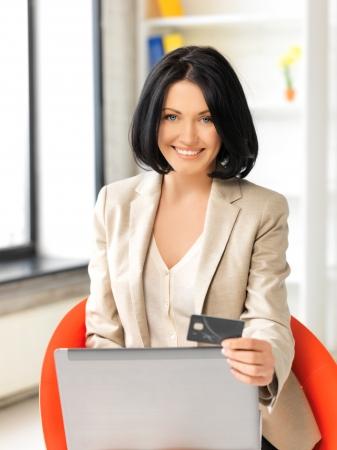 picture of happy woman with laptop computer and credit card Stock Photo - 13842200