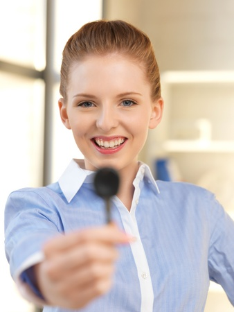 gorgeous businesswoman: bright picture of happy woman with car key Stock Photo