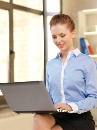 bright picture of happy woman with laptop computer Stock Photo - 13842261