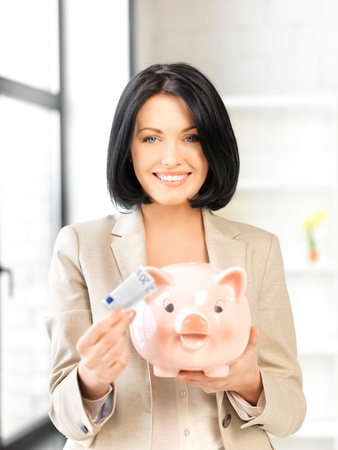 picture of lovely woman with piggy bank and money Stock Photo - 13902413