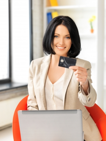 picture of happy woman with laptop computer and credit card Stock Photo - 13902420