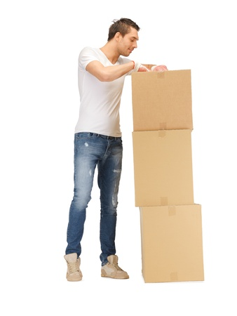 few: picture of handsome man with big boxes  Stock Photo
