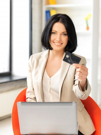 picture of happy woman with laptop computer and credit card photo