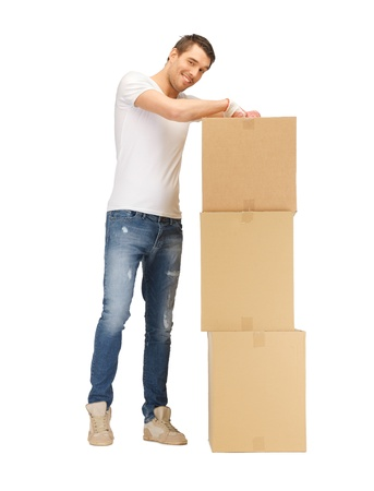 picture of handsome man with big boxes  photo