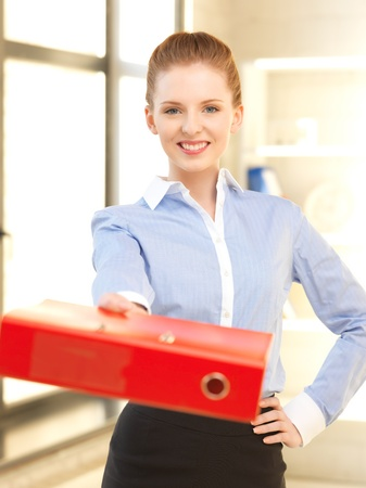 bright picture of beautiful woman with folder Stock Photo - 13957148