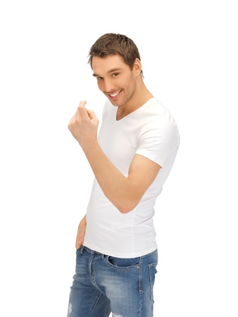 come up to: handsome man in white shirt making inviting gesture Stock Photo