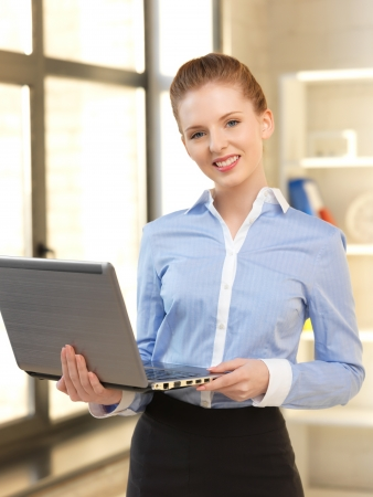 bright picture of happy woman with laptop computer Stock Photo - 14032573