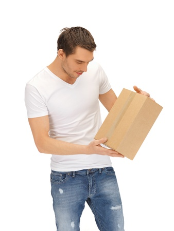 handsome man in white shirt with parsel Stock Photo
