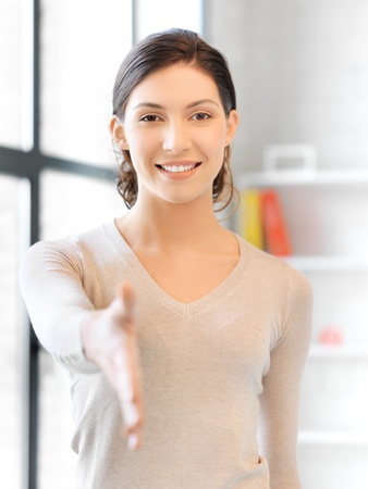 agree: lovely woman with an open hand ready for handshake
