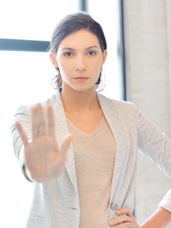 woman stop: picture of young woman making stop gesture Stock Photo