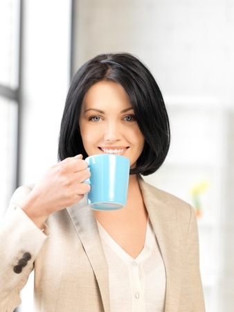 woman drinking tea: bright picture of lovely businesswoman with mug