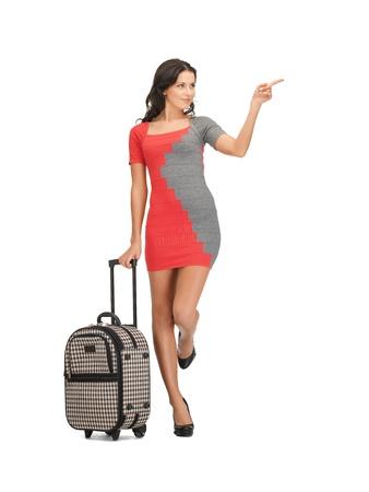 bagage: belle femme avec valise pointant son doigt Banque d'images