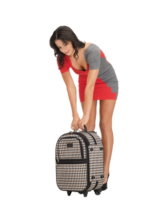 bright picture of unhappy woman with heavy suitcase Stock Photo - 14048039