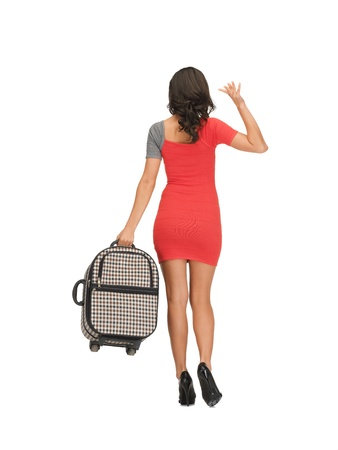 bright picture of woman with suitcase waving hand photo