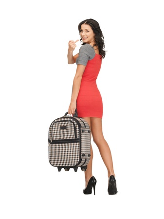 happy woman with suitcase showing middle finger photo