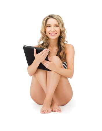 releaxed: picture of happy woman in bikini with tablet pc computer Stock Photo