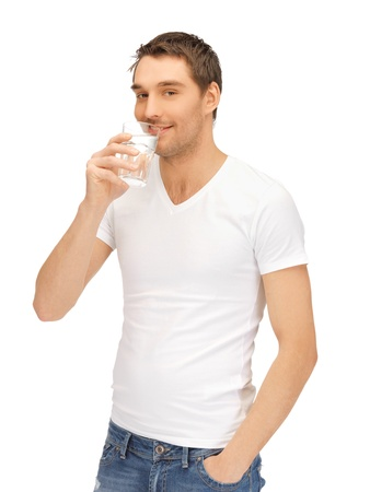 man drinking water: handsome man in white shirt with glass of water Stock Photo