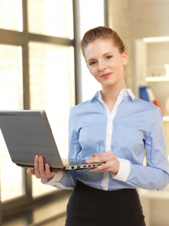 bright picture of happy woman with laptop computer Stock Photo - 14067009