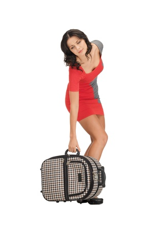 bright picture of unhappy woman with heavy suitcase Stock Photo - 14067045