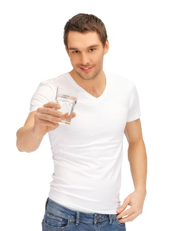energy drinks: handsome man in white shirt with glass of water Stock Photo