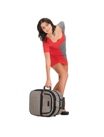 bright picture of unhappy woman with heavy suitcase Stock Photo - 14080495