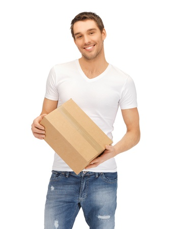 package shipment: handsome man in white shirt with parsel Stock Photo