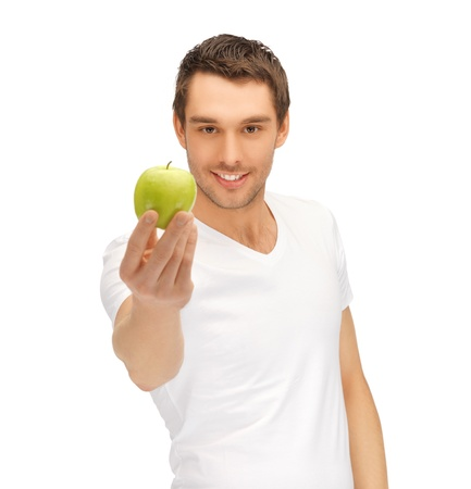 healthy person: handsome man in white shirt with green apple