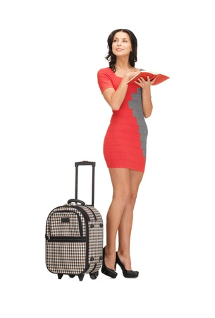 bright picture of lovely woman with suitcase and book Stock Photo - 14113850