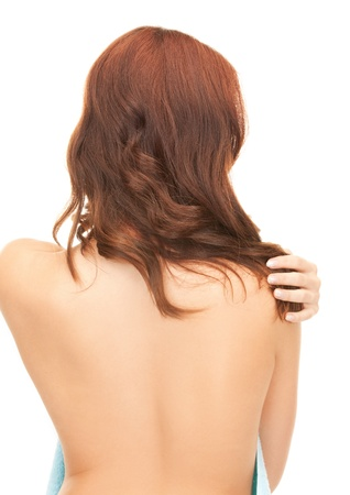 naked girl body: bright picture of woman with long hair from the back Stock Photo